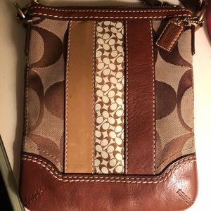 Brown Authentic coach strap bag.